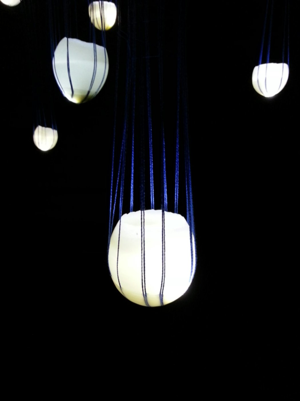 abbie r powers installation art made of silk and string, wax, light