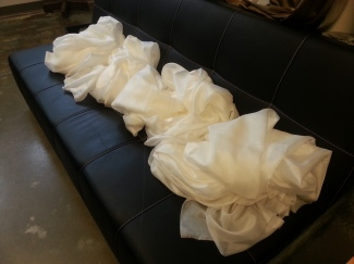 bundles of silk awaiting their turn with the sewing machine